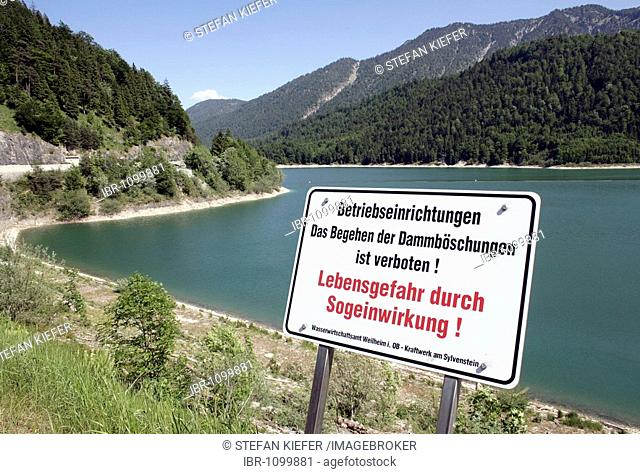 Warning sign, danger of life, on the dam wall on Sylvenstein reservoir where the Isar River is dammed, in Fall near Lenggries, Bavaria, Germany, Europe