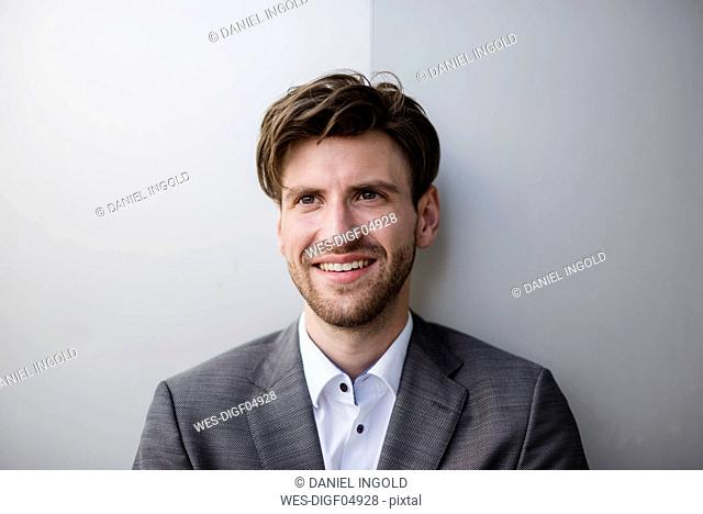 Portrait of confident businessman at a wall