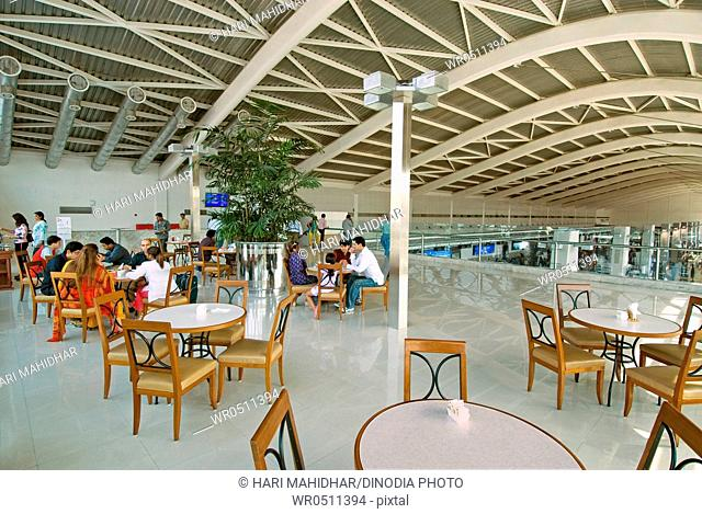 Passengers in cafeteria of chhatrapati shivaji international airport , Santacruz , Bombay Mumbai , Maharashtra , India