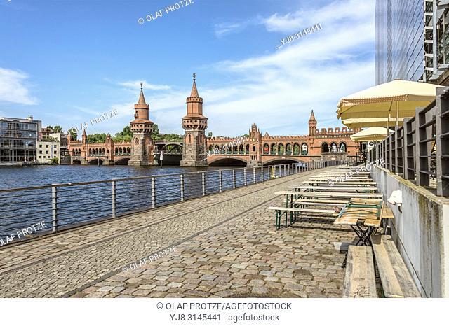 Oberbaumbruecke Berlin seen from Spreespeicher river bank, Germany