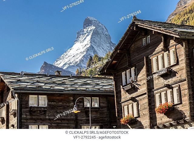 Traditional houses in the village of Zermatt with Matterhorn in the background. Valais, Switzerland Europe