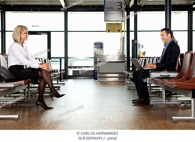 Businesspeople in departure lounge of airport