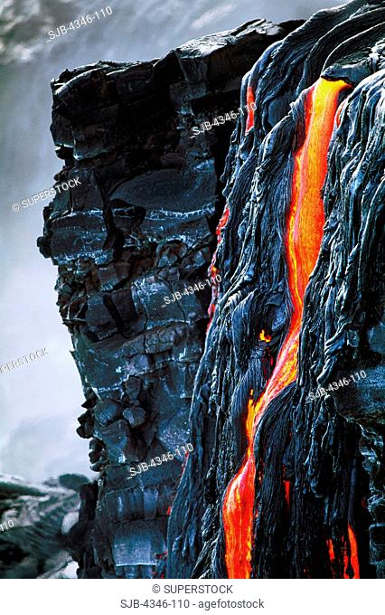 A River of Glowing Hot Pahoehoe Lava Flows Over a Cliff