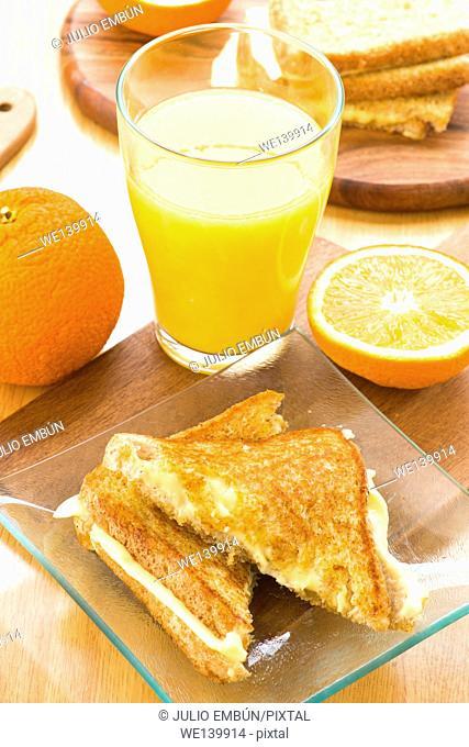 fresh orange juice and cheese sandwich