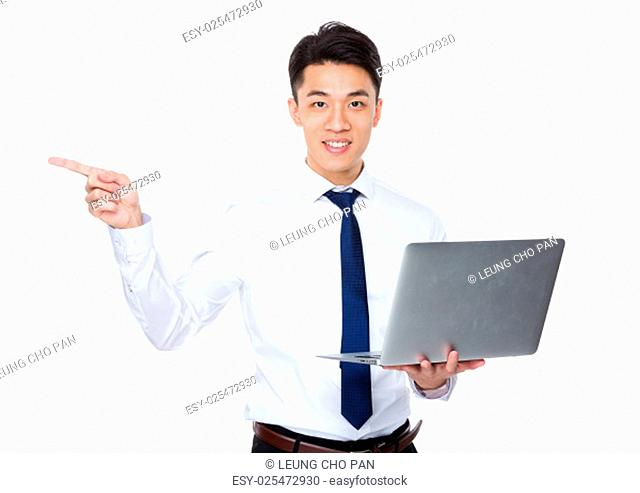 Young businessman hold with laptop and finger point up