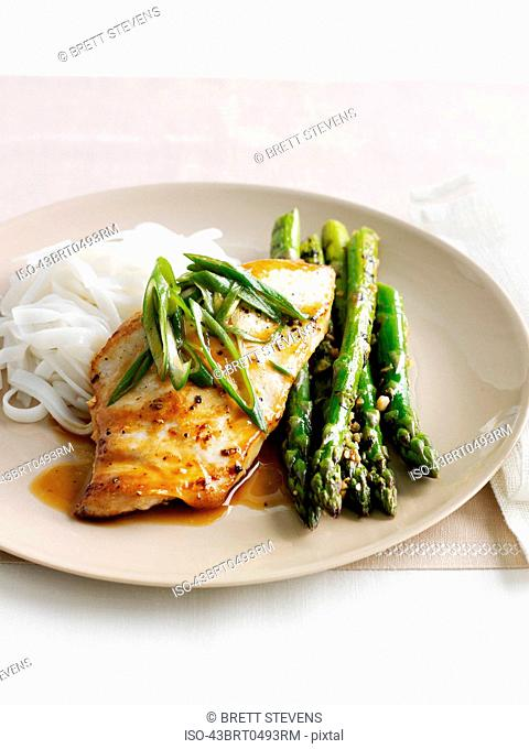 Plate of chicken, asparagus and noodles