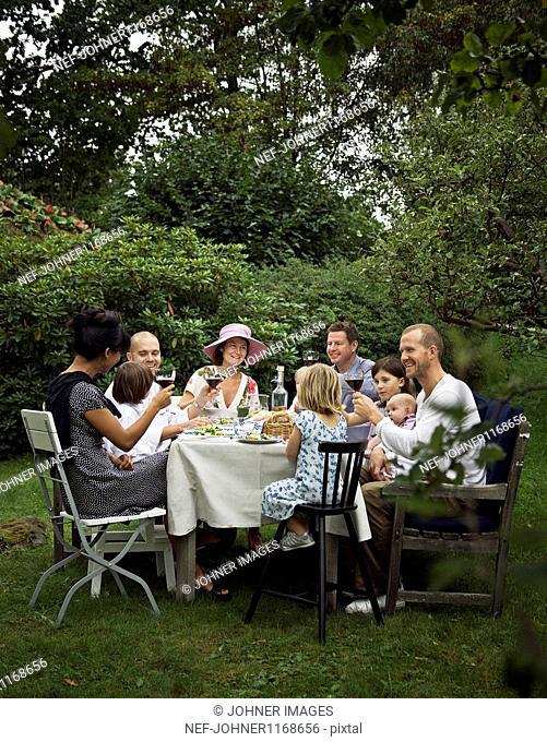 Family eating dinner in garden