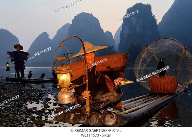 Chinese fishermen with cormorants at dawn on the Li river Yangshuo China