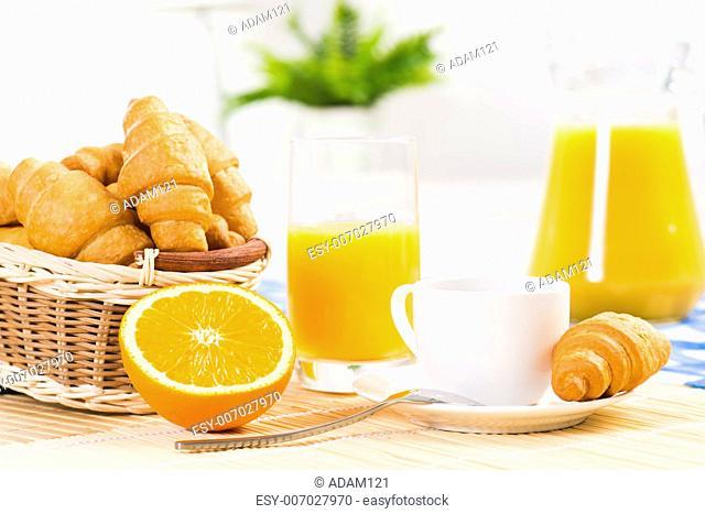 early breakfast, orange, coffee, croissants and orange juice
