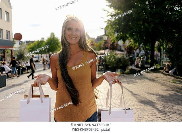 Portrait of lauging woman with shopping bags