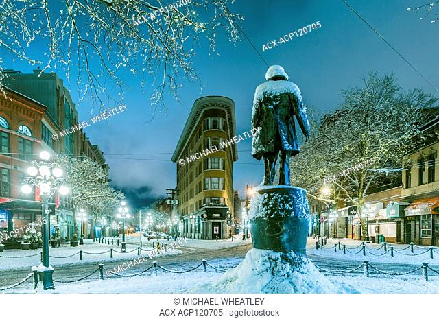 Hotel Europe and Grassy Jack statue with snow in winter, Gastown, Vancouver, British Columbia, Canada