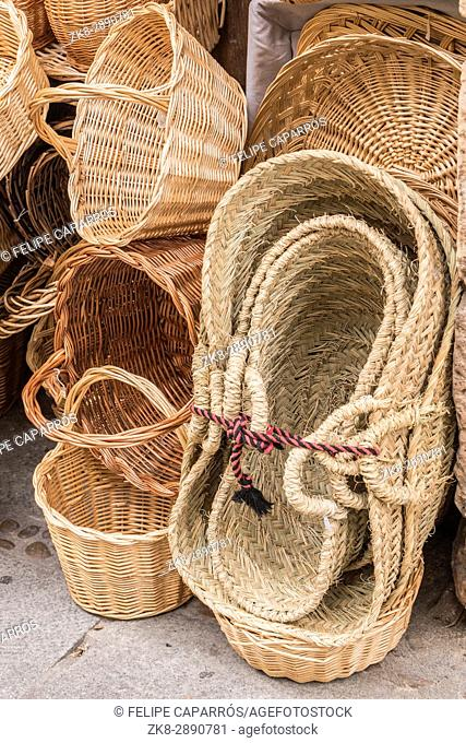 Wicker hand-made baskets at the shop of a touristic street of Segovia Castilla and Leon Spain