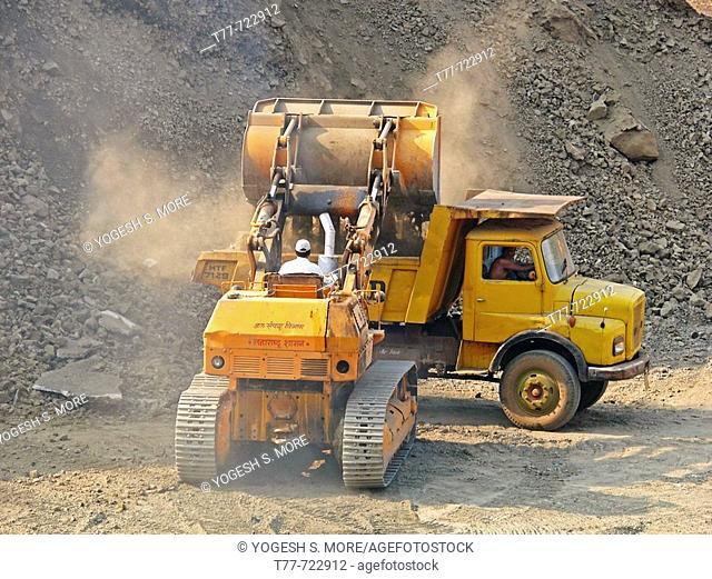 Bulldozers in rock quarry  Kolkewadi, Ratnagiri, Maharashtra, India