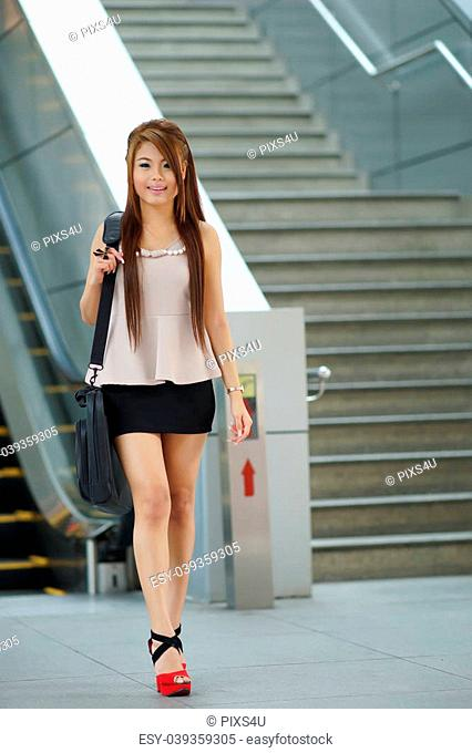 Portrait walking escalator Stock Photos and Images | age