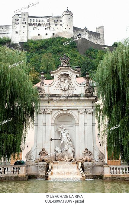 Low angle view of Hohensalzburg Castle and Neptune fountain, Salzberg, Austria