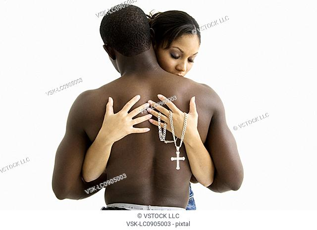 African American couple holding each other