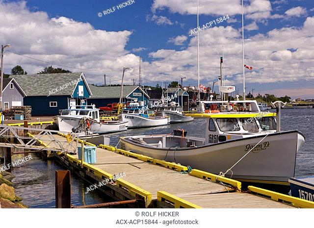 Fishing boats tied up to the wharf in the town of North Rustico, North Rustico Harbour, Gulf of St Lawrence, Highway 6, Blue Heron Coastal Drive, Queens