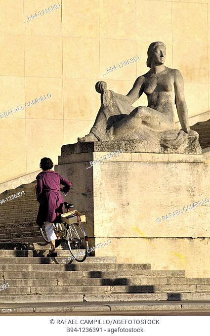 Girl climbing stairs with bicycle. Trocadero area. Chaillot Palace. Pomone, sculpture by Robert Wlérick, 1937. Paris, France