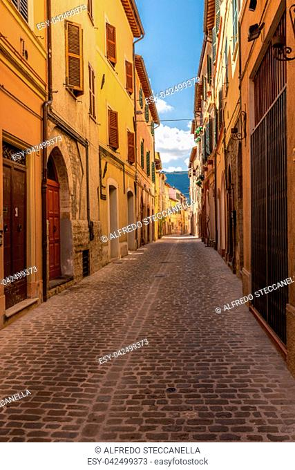 Characteristic narrow street of an Italian medieval city