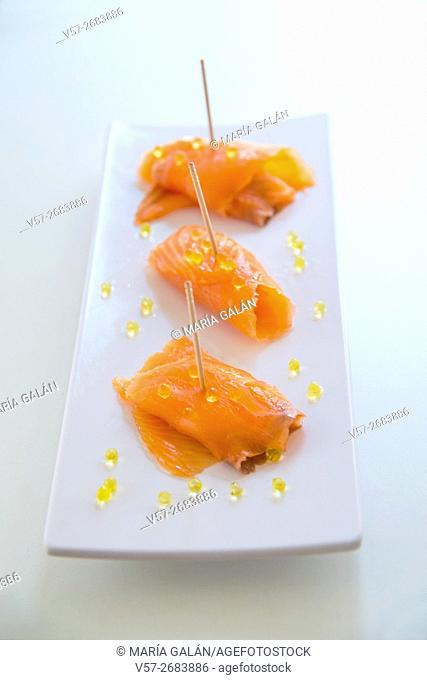 Smoked salmon with pearls of olive oil
