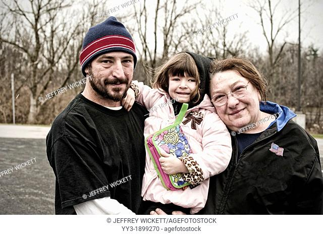 Man, woman and child posing together and happy