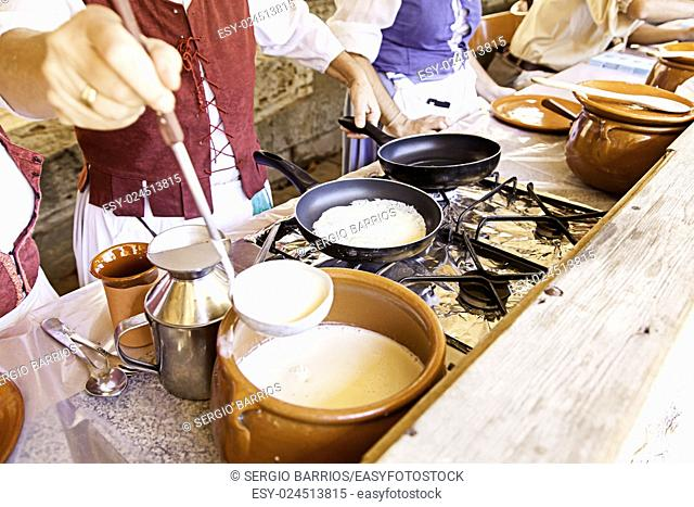 Cooking pancakes on a fair, detail of a position in a market, healthy food, party. in Spain
