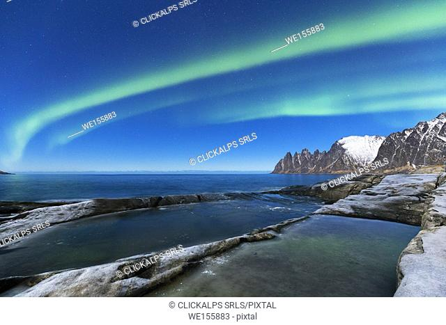 Northern lights above the bay facing Tungeneset. Tungeneset, Ersfjorden, Senja, Norway, Europe