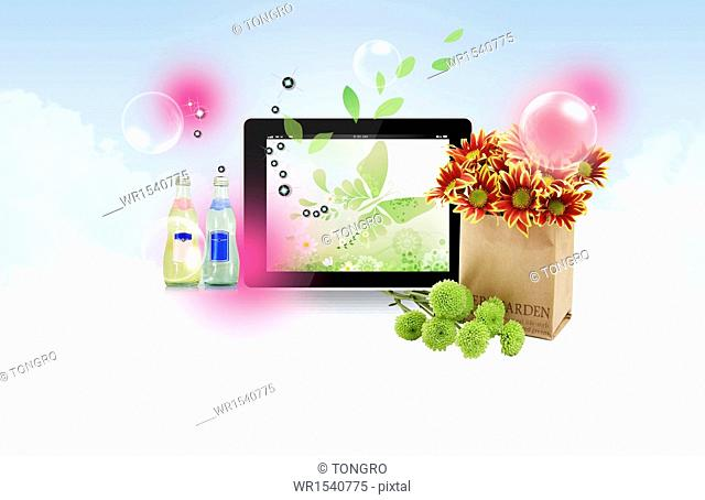 a screen next to a bag of flowers