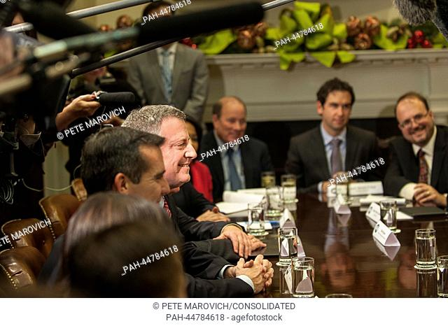 New York City mayor-elect Bill de Blasio sits across from United States President Barack Obama and Vice President Joe Biden during a meeting with a group of...
