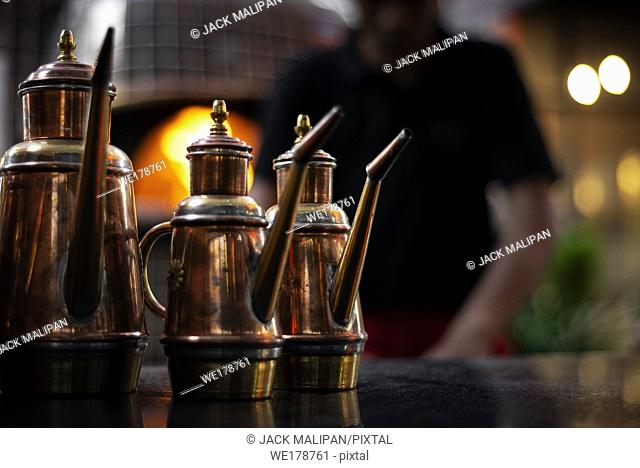 classic olive oil copper cruet traditional dispenser detail in italian restaurant