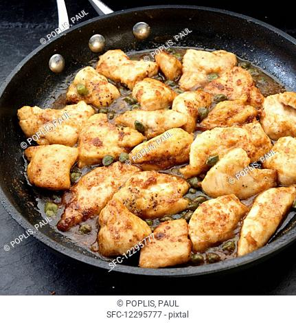 Chicken breast pieces sauted with olive oil and capers