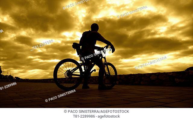 Cyclist at dawn. Peniscola, Valencian Community, Spain