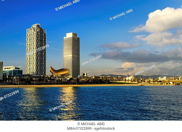 Coastline of Barcelona on a sunny day with a view of hotel towers, Spain