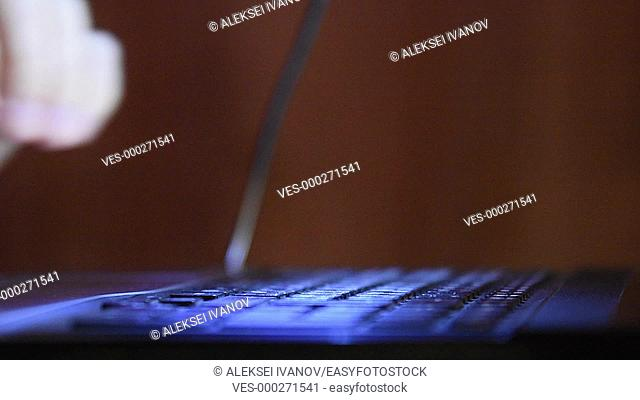 Hands typing on a laptop keyboard, close-up