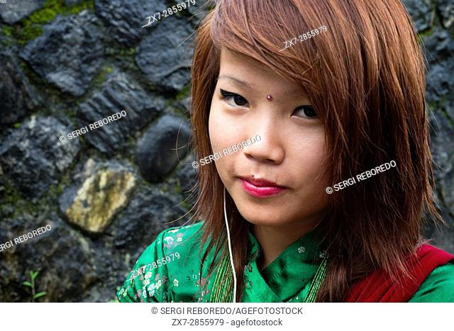 Portrait of a young nepalese girl near Bandipur Hanging bridge in Nepal. Kathmandu Valley