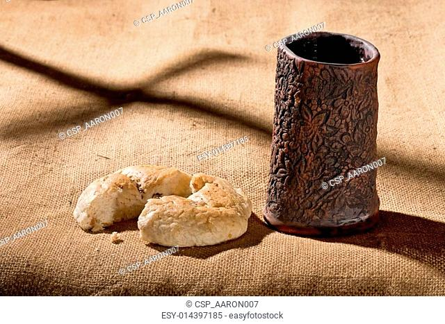 Communion cup with wine and bread Stock Photos and Images