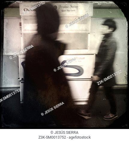 Men walkings in Metro, Madrid, Spain