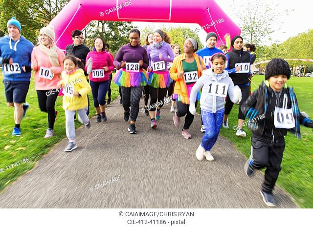 Runners running at charity run in park