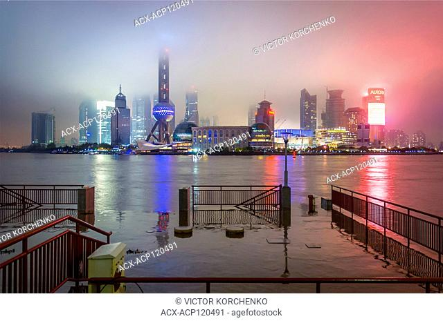 Oriental Pearl TV tower and Pudong skyline in the mist, Shanghai