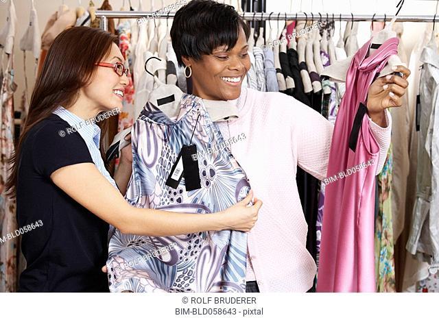 Multi-ethnic women clothes shopping