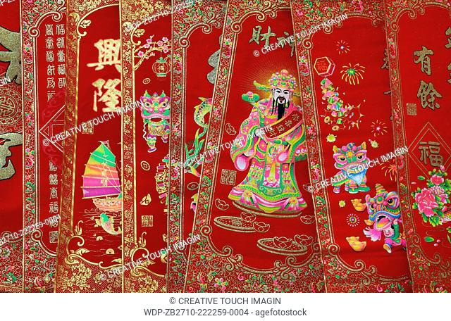 Decorative Chinese banners, including one with the image of the Chinese God of Prosperity, for sale during the Chinese Lunar New Year of the Snake