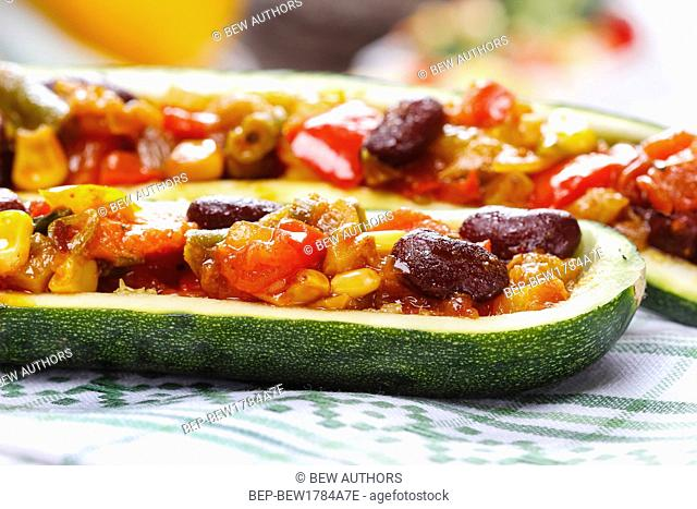 Zucchini stuffed with vegetable salad