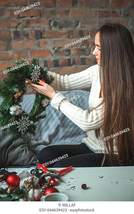 Perfect Young Woman Making Christmas Decorations at Home