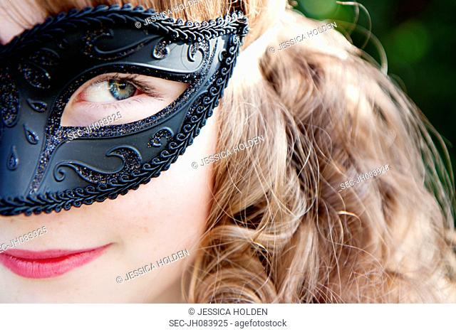Close-up view of girl (10-12) wearing mask