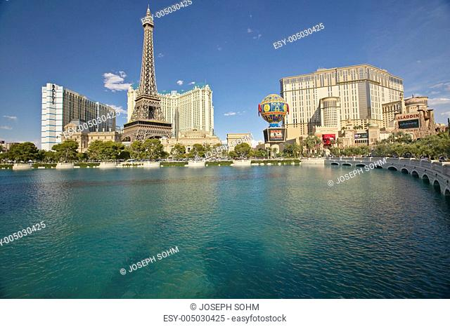 Water fountain display at Bellagio Casino with Paris Casino and Eiffel Tower in Las Vegas, NV