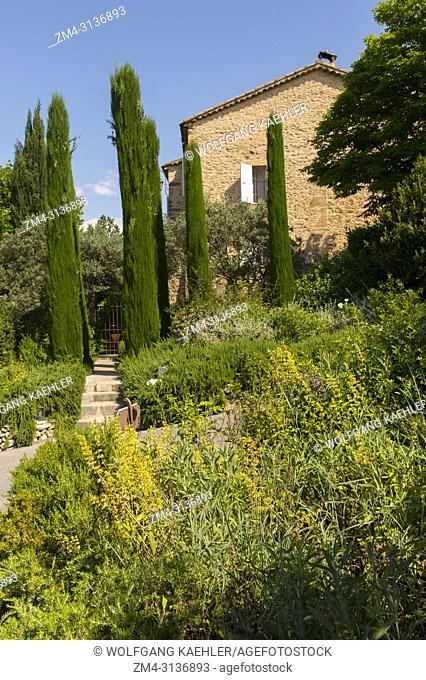 View of La Bastide de Moustiers, a house converted to a hotel, in Moustiers-Sainte-Marie, a medieval village in Alpes-de-Haute-Provence region in southern...