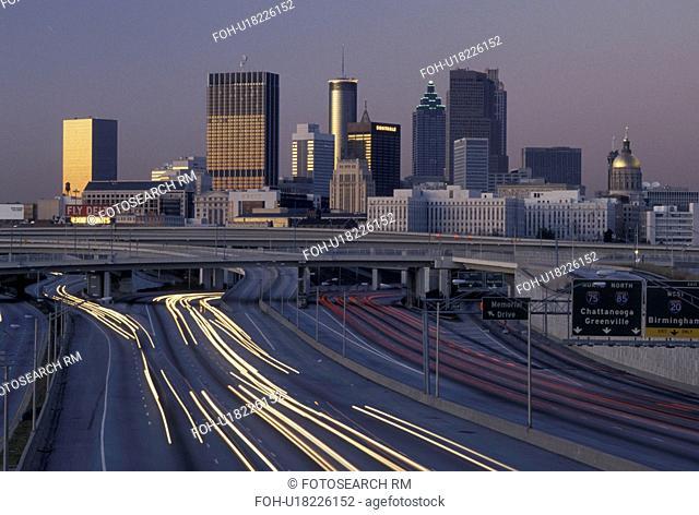 expressway, Atlanta, GA, skyline, Georgia, Traffic lights streak on I-75/I-85 at sunset and view of the skyline of downtown Atlanta
