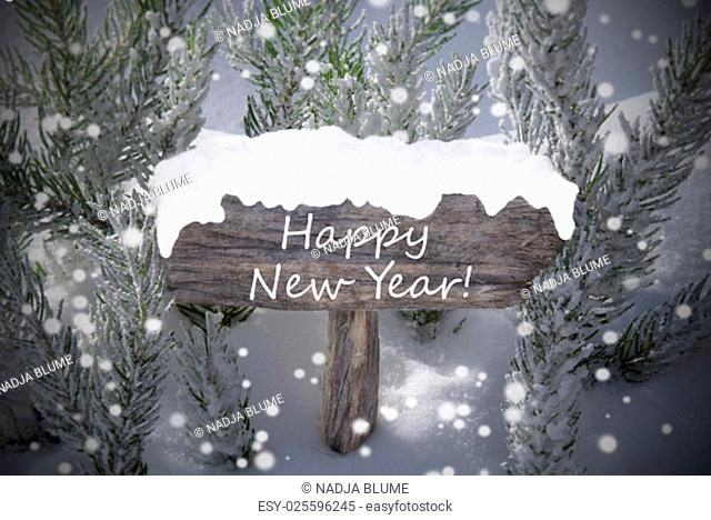Wooden Christmas Sign With Snow And Fir Tree Branch In The Snowy Forest. English Text Happy New Year For Seasons Greetings Or Happy New Year Greetings