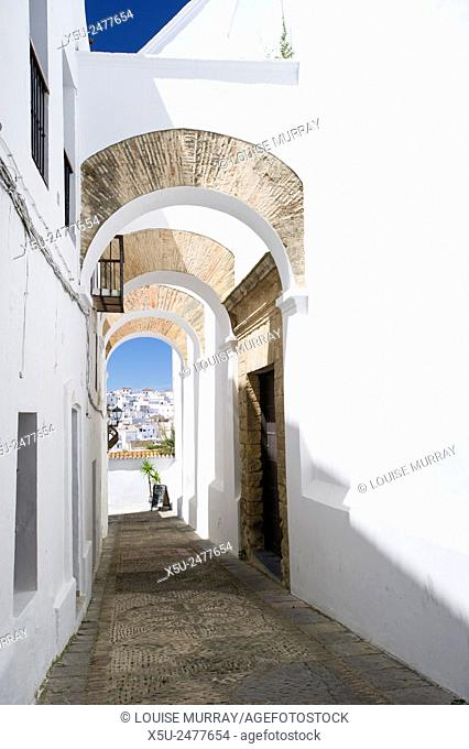 Elegant arched architecture in the narrow lanes of the picturesque village of Vejer de la Frontera, voted by the Spanish as the most beautiful village in Spain