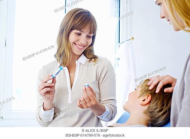 Doctor giving homeopathy to a child
